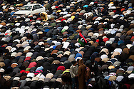 Men pray during friday prayers in the square in Benghazi. Open prayer was banned as was attending mosques during Qadaffi's rule on March 4, 2011.