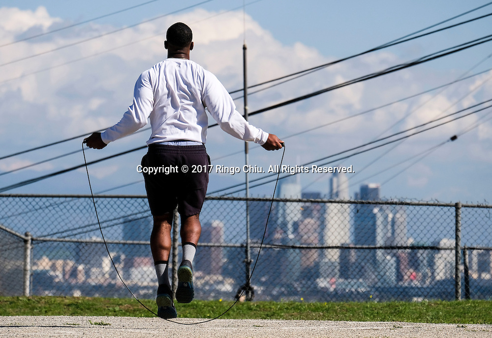 A man works out as the Los Angeles downtown skyline is seen at Kenneth Hahn park in Los Angeles on Tuesday January 24, 2017(Photo by Ringo Chiu/PHOTOFORMULA.com)<br /> <br /> Usage Notes: This content is intended for editorial use only. For other uses, additional clearances may be required.