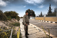 A Young Greek Cypriot Soldier Before The Ceasefire Line between Greeck and Turkish Areas controlled by UN