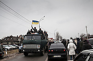 Perched on an army truck, anti-government protesters arrive at the residence compound of former Ukrainian President Viktor Yanukovych's in Mezhygirya, near Kiev on February 22, 2014 in Kiev, Ukraine.