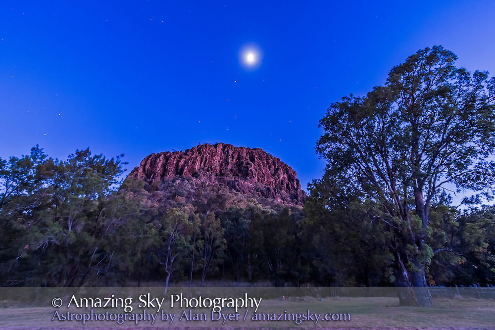 The waning last quarter Moon above Timor Rock at Timor Cottage, Coonabarabran, Australia, DEc 5/6, 2012 pre-dawn in the twilight. Camera on tripod exposure with Canon 60Da and 10-22mm lens at 10mm and f/3.5 for 10s at ISO 400. Moon is just above Regulus in Leo.