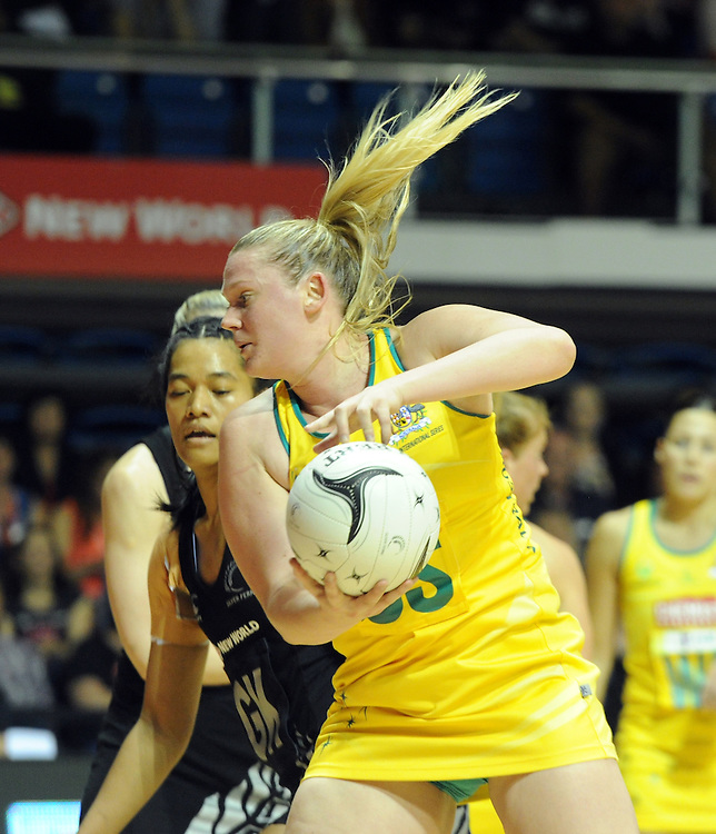 Australia's Caitlin Thwaites, right, takes the ball in front of New Zealand's Temalisi Fakahokotau in the Constellation Cup International netball game at The Trusts Arena, Waitakere, Auckland, New Zealand, Wednesday, October 15, 2014. Credit:SNPA / Ross Setford
