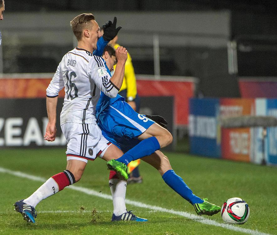 Robert Bauer  of German, left, forces Eldor Shomurodov of Uzbekistan out in the Under 20 soccer World Cup match, Christchurch, New Zealand, Thursday, June 04, 2015. Credit:SNPA / David Alexander