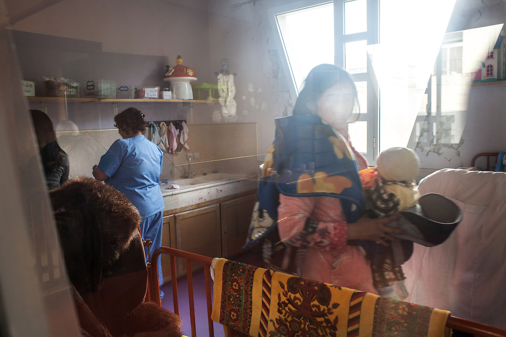 Casablanca, 2015. Imaam is going home with her little boy, after one of her long days of work in the restaurant of the association. She comes from a small village near Khenifra and is just 18 years old. She arrived nine months ago after the birth of her son when she met one of the social workers from the association Solidarit&egrave; Feminine. The association helps women and children in distress by offering them shelter (no one in Morocco would rent a house to a single mother), children's healthcare, literacy and job placement for the mothers. It offers them the opportunity to start over and to conquer autonomy and self-sufficiency that for many of them is still a mirage. <br /> /All names are changed to protect the true identity of the people /