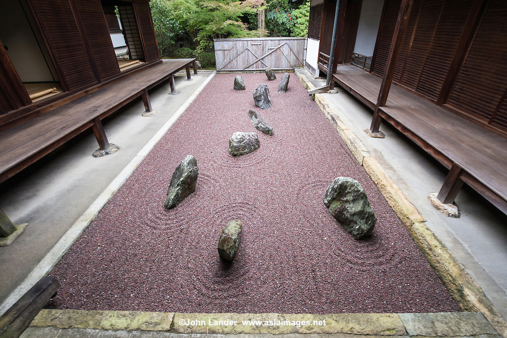"Ryogin-an Eastern garden is the ""Garden of the Inseparable"".  This garden uses purple gravel that is not common for zen gardens, an indicator of the modernity of its of its design.  Ryogin-an gardens were designed by Shigemori Mirei the renowned landscape architect and garden designer who designed other gardens at Tofukuji, as well as other venues in Kyoto and Japan."