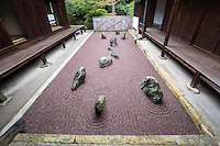 """Ryogin-an Eastern garden is the """"Garden of the Inseparable"""".  This garden uses purple gravel that is not common for zen gardens, an indicator of the modernity of its of its design.  Ryogin-an gardens were designed by Shigemori Mirei the renowned landscape architect and garden designer who designed other gardens at Tofukuji, as well as other venues in Kyoto and Japan."""
