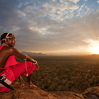A Samburu Moran surveys a vast landscape unscarred by industrial development in northern Kenya
