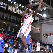 Grand Rapids Drive Center Hasheem Thabeet (34) drives towards the basket as Delaware 87ers Forward Joel Wright (14) defends in the second half of a NBA D-league regular season basketball game between the Delaware 87ers and the Grand Rapids Drive (Detroit Pistons) Saturday, Apr. 04, 2015 at The Bob Carpenter Sports Convocation Center in Newark, DEL.