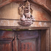 A statue of Ganesh adorns the doorway of an ancient house in Varanasi, India.