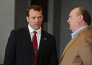 Ross Bjork, left, visits with Steve Davenport before being announced as the new athletic director at the University of Mississippi at a press conference at Vaught-Hemingway Stadium in Oxford, Miss. on Thursday, March 22, 2012.  (AP Photo/Oxford Eagle, Bruce Newman)