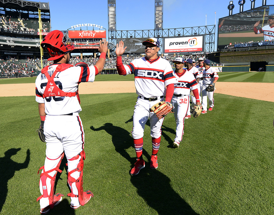 CHICAGO - APRIL 23:  Avisail Garcia #26 and Omar Narvaez #38 of the Chicago White Sox celebrate after the game against the Cleveland Indians on April 23, 2017 at Guaranteed Rate Field in Chicago, Illinois.  The White Sox defeated the Indians 6-2.  (Photo by Ron Vesely)   Subject:  Avisail Garcia; Omar Narvaez
