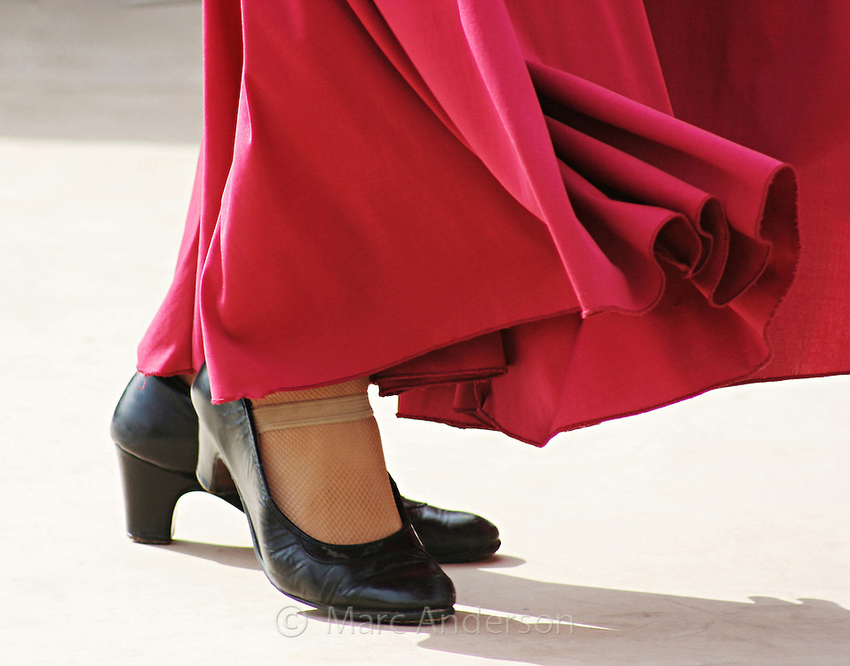 A Spanish dancer's shoes with her red skirt moving, Andalucia, Spain.