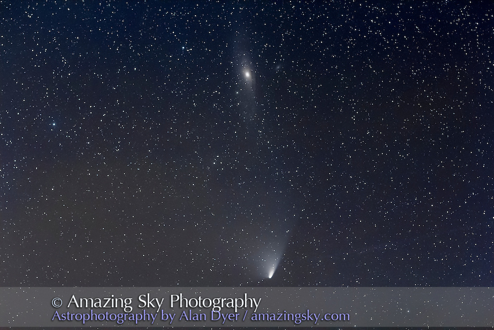 Comet PANSTARRS C/2011 L4 low in NW sky wiyh M31, the Andromeda Galaxy, on April 1, 2013. This is a stack of 2 x 60 second exposures with the Canon 135mm lens at f/2.8 and Canon 60Da at ISO 1600, on the Kenko SkyMemo tracking platform. Objects were very low and in the murk!