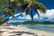 Beach and dive boats at Matangi Private Island Resort, Fiji.