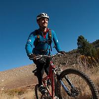Mountain biking on Lower Rock Creek through desert vegetation.