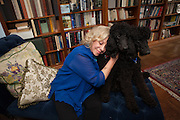 New York, NY - October 03, 2013 : Author Erica Jong with her 10-month old poodles Collette (red collar) and Simone (blue collar), at her apartment in New York, NY on October 03, 2013. Fear of Flying, celebrating its 40th anniversary, is a 1973 novel by Erica Jong, which became famously controversial for its attitudes towards female sexuality, and figured in the development of second-wave feminism.