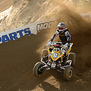 Dana Creech (#52) roosts the banners during the moring qualifing session of the ATVA Round #1 Nationals at Glen Helen.