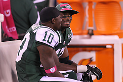 October 17, 2011; East Rutherford, NJ, USA; New York Jets wide receiver Plaxico Burress (17) and New York Jets wide receiver Santonio Holmes (10) talk on the bench during the first half at the New Meadowlands Stadium.