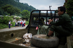 Laiza 20160913<br /> A group of children passes a K.I.A. rebell truck on their way to school in Laiza, Kachin state, Myanmar. <br /> Photo: Vilhelm Stokstad / Kontinent