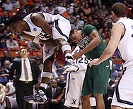 Xavier guard/forward C.J. Anderson fouls Portland State forward Jamie Jones in the first round of the NCAA men's basketball tournament at Taco Bell Arena in Boise, ID.