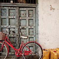 Bike, gerry cans and door in Stonetown, Zanzibar