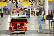 The first Chevrolet Volt battery moves through the assembly process at the General Motors Brownstown Battery plant in Brownstown Township, Michigan Tuesday, December 22, 2009. The Brownstown facility is the first lithium-ion battery pack manufacturing plant in the U.S. operated by a major automaker. (Jeffrey Sauger)