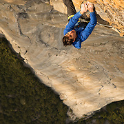 Alex Honnold climbing the 5.12 free variation pitch near the top of the Salathe Wall on El Capitan, Yosemite National Park.