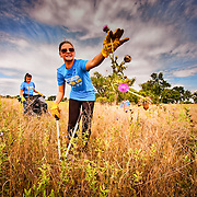 Southwest Airlines Employee-Volunteers clear invasive plants from a field near Denver, CO