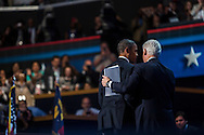 President Barack Obama and former President Bill Clinton leave the stage together after Clinton's speech at the Democratic National Convention on Wednesday, September 5, 2012 in Charlotte, NC.