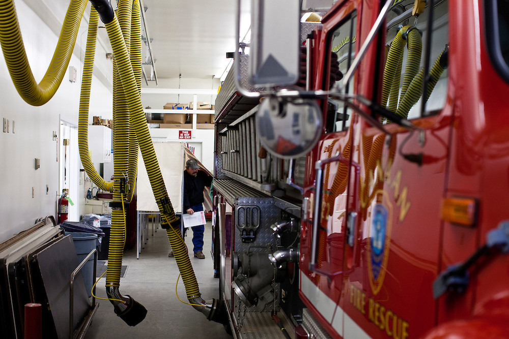 A voter emerges from a voting booth after casting his ballot in the New Hampshire Primary in the Canaan Fire Station on Tuesday, January 10, 2012 in Canaan, NH. Brendan Hoffman for the New York Times