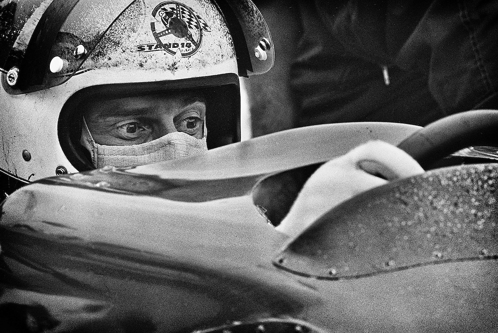 During the 1972 United States Grand Prix, French Marlboro-BRM F1 driver Jean Pierre Beltoise tries to become comfortable with a fitted aerodynamic &quot;shelf&quot; installed on his P180 chassis. <br /> <br /> The team believed the this fairing would decrease cockpit buffeting and increase top speed. It was not to be used in the race. <br /> <br /> Earlier in the season, Beltoise won the Monaco Grand Prix, in intense rain, for his first, and ultimately only Grand Prix victory in his career. It would also prove to the final victory for the BRM (British Racing Motors) team. <br /> <br /> Without operational data retrieval sensors, evaluation of any advantage with aerodynamic or suspension modifications could only be experienced hands-on. It was during these testing sessions that drivers of the 1960's, 70's, and 80's faced their greatest risks. <br /> <br /> Material failures were a weekly reality, and experimental mods increased those risks. There were no cad/cam advances, no fluid dynamics models, no wind tunnels. In fact there were no computers, no telemetry, no simulators, no carbon fiber, no deformable structures, or Hans devices; nothing of the safety and technological advances and aids that make today&rsquo;s F1 machines so incredibly safe. <br /> <br /> When driver's such as Jean-Pierre Beltoise left the pits, their only tools were their massive reflexes, their accumulated knowledge and the best guesses of their engineer.