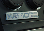 "Special WRP10 Badging.Subaru Impreza WRX WRP10 - a limited edition model exclusive to the Australian market. .The WRP10 was available from late January 2005 and was limited to 200 units, featuring individually numbered badges..The model name comes from Subaru's heritage, the ""WR"" represents Impreza WRX's success in World Rally competition, ""P"" the enormous rallying contribution from Pirelli tyres and ""10"" the years since launch of the original Impreza WRX""..Available exclusively in Crystal Grey Metallic manual sedan, the WRP10 includes a STI engine performance upgrade kit increasing peak power from standard WRX's 168 kW @ 6,000 rpm to175kW @ 6,000 rpm..The kit includes a replacement Electronic Control Unit, upgraded exhaust components and a unique large single tip muffler..A carbon fibre strut brace and WRX suspension lowering kit, with stiffer springs drop the car's ride height by 15mm..WRP10 is finished off with high performance, lightweight five-spoke forged alloy RAYS wheels and Pirelli P Zero Nero tyres (215 45Z R 17 91Y)..The limited edition model was the first developed by STI Australia, in conjunction with STI Japan .(C) Joel Strickland Photographics.Use information: This image is intended for Editorial use only (e.g. news or commentary, print or electronic). Any commercial or promotional use requires additional clearance."