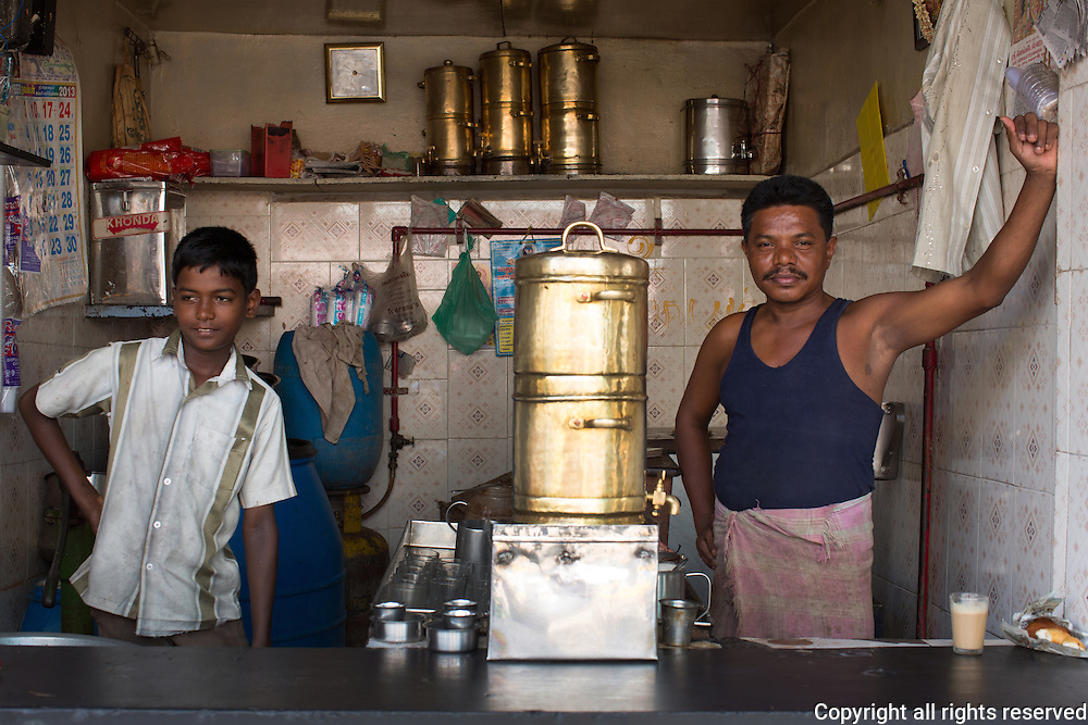 A typical coffee shop in Madurai, Tamil Nadu. Brass urns (center) are used for making vats of drip coffee which is served with hot milk.