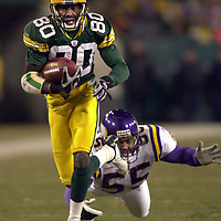 The Packers Donald Driver gets a 15-yard gain in the second quarter as the Vikings' Lemanski Hall dives to bring him down.  The Green Bay Packers Hosted the Minnesota Vikings at Lambeau Field in Green Bay, Sunday December 8, 2002. WSJ/Steve Apps.