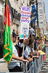 St James, London, May 12th 2016. Tamil, Afghan, Nigerian and Biafran protesters demonstrate outside the anti-corruption conference taking place at Lancaster House. PICTURED: A protester's placard welcomes Afghan President Ashraf Ghani.