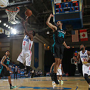 Delaware 87ers Guard RUSS SMITH (0) drives towards the basket as Greensboro Swarm Forward Perry Ellis (34) defends in the first half of an NBA D-league regular season game between the Delaware 87ers and the Greensboro Swarm (Charlotte Hornets) Wednesday, March 29, 2017, at The Bob Carpenter Sports Convocation Center in Newark, DEL