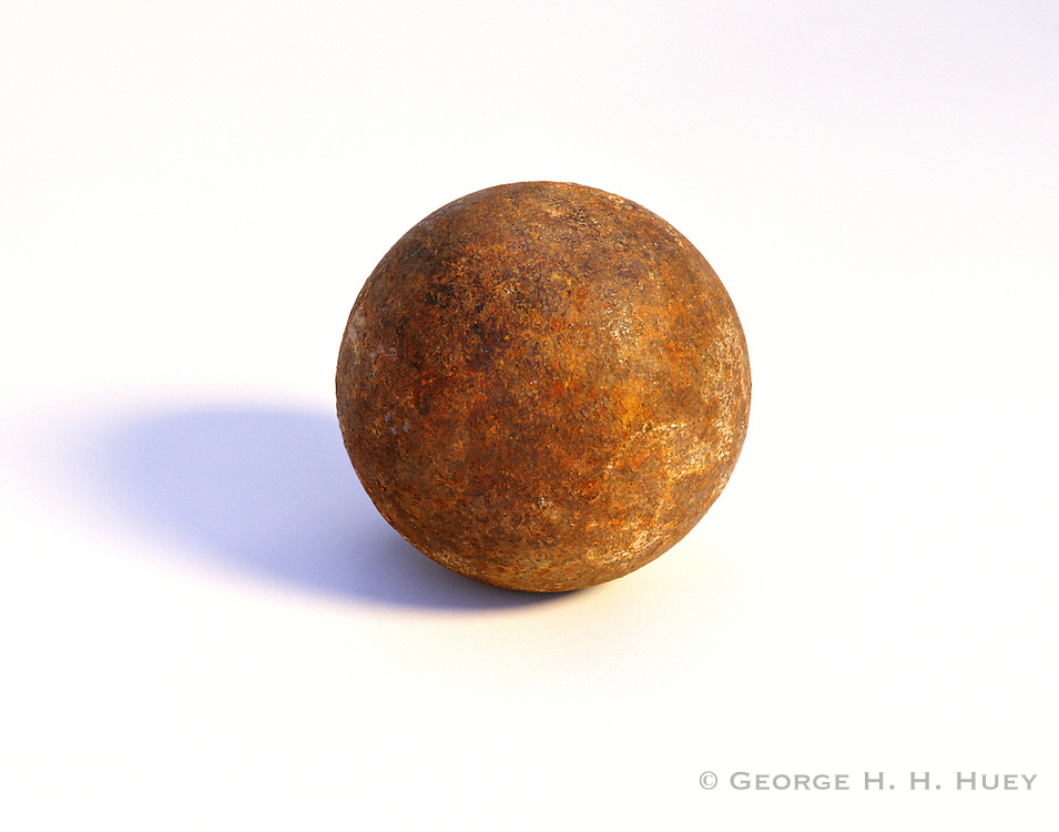 0210-1035 ~ Copyright: George H.H. Huey ~  Civil War cannonball found on the Glorieta Battlefield near Pecos, New Mexico.  1862.  Probably from a Howitzer cannon, belonging to the Union Army.  Pecos National Historical Park, New Mexico.