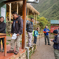 Peru, Piscacucho, Hikers gathered at checkpoint at base of Dead Woman's Pass along Inca Trail to Machu Picchu along Urubamba River