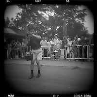 Asia, China, Beijing, Blurred black and white image of man taking snapshots near Gate of Heavenly Peace in the Forbidden City on summer afternoon