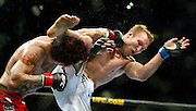 """UFC Middleweight """"Swing"""" fighter Chris Leben gets in a powerful knockdown punch on the chin of Jake Rosholt who misses with a kick during their bout. The UFC 102 live from the Rose Garden featured many fights with Rosholt winning this one finally by submission."""