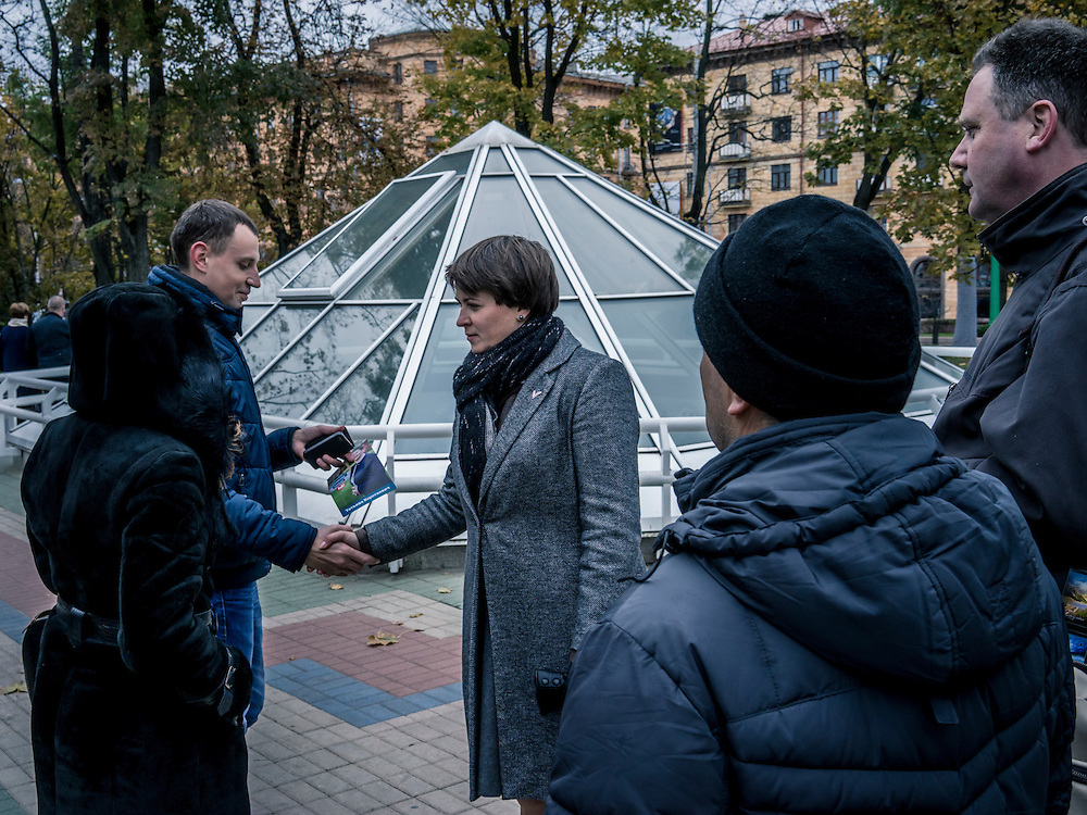 Tatyana Karatkovich, center, who is running for president of Belarus against longtime strongman Alexander Lukashenko, shakes hands with a supporter after a campaign event on Friday, October 9, 2015 in Minsk, Belarus.