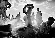 Food stall in a refugee camp in Tanzania.  apr. 1994 -<br /> The sun had set over the rwandan capital Kigali as president Juvenal Habyarimana's plane approached the city's airport on 6.april 1994.Suddenly, out of the darkness, a rocket hit the plane and sent it crashing to the ground, killing everyone on board.over the next three month's, more than 800.000 rwandans would be murdered, many cut down with machetes, killed by neighbours and countrymen, in a ferocious ethnic genocide that was all but ignored by the international world.