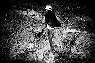 Khazan, around 12, from Armenia, is climbing a wall during  a walk near the center. FEDASIL Sugny asylum center. Sugny, Belgium. October 2015. I took these photographs during an international volunteer program that I liderate with an international volunteering group.