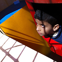 Mourhaf is six years old. He was born both deaf and blind, although he can distinguish between pitch blackness and very bright lights. He likes to jump on trampolines and to stare at the sun. During weekdays, he lives at the Holy Land Institute for the Deaf, a school for deaf and deaf-blind children in the city of Salt, Jordan.