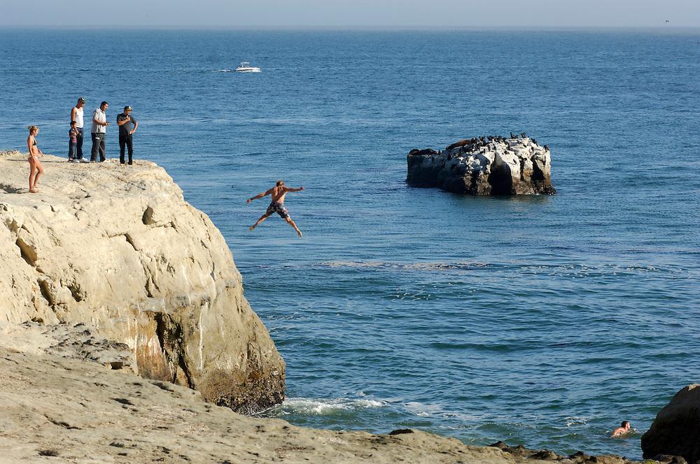 Brave jumping into sea, Lighthouse Field State Park, Santa Cruz, California, United States of America