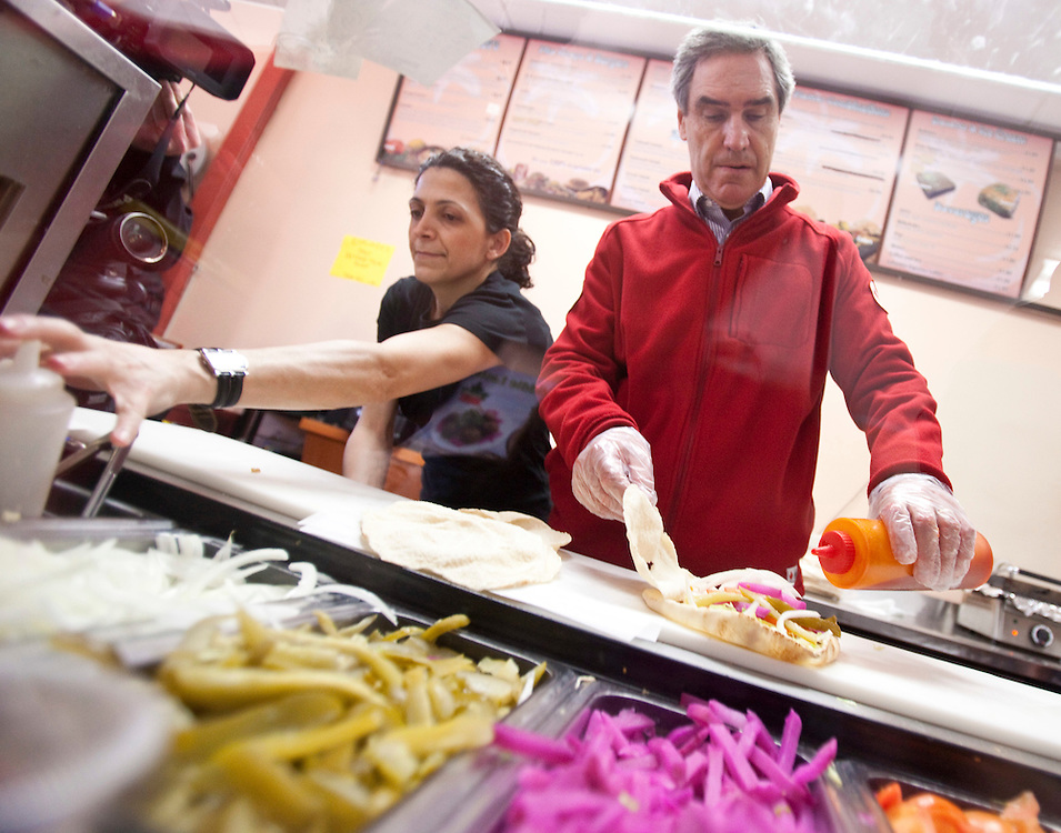Liberal leader Michael Ignatieff makes a shawarma during a campaign stop in London, Ontario, Friday April 29, 2011.<br /> REUTERS/Geoff Robins (CANADA)
