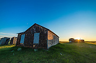 Sunset over the cabins and rustic buildings at the Larson Ranch site in the Frenchman River valley in Grasslands National Park, Saskatchewan. Note the waxing crescent Moon in the sky. <br /> <br /> This is one frame from a 300-frame time-lapse sequence with the 14mm lens and Canon 6D.