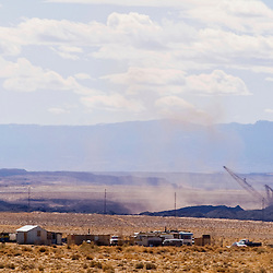 A Navajo family lives close to the Navajo Mine of Fruitland, N.M. Draglines operate at the mine 24-hours a day.