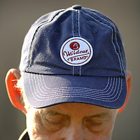 Kelly Roark showed his affection for the Kentucky Wildcats on his hat in Wild Cat, Ky., on 3/19/10. Photos by David Stephenson