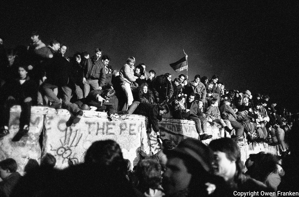 New Year's Eve 1989, revelers celebrating the fall of the Berlin Wall